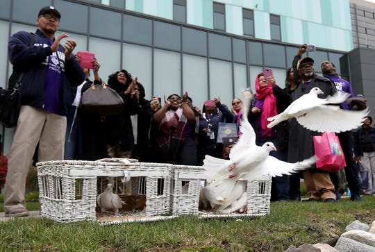 People who attended a domestic violence seminar held at the Detroit Public Safety Headquarters in Detroit on Friday, October 26, 2018 take pictures of a white dove release. The homing pigeon and dove hybrids are from Dreamers White Dove Release a family business in Saginaw.