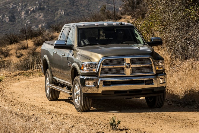 """The 2017 Ram 2500 Laramie Longhorn Crew Cab 4x4 Heavy Duty was offered with a Cummins Diesel engine. FCA said its posted  third quarters earnings loss reflected an estimated $794 million charge related to a U.S. Department of Justice investigation that alleges the automaker failed to disclose software on about 104,000 diesel-powered pickups and SUVs that regulators said could be similar to the """"defeat devices"""" Volkswagen AG used to cheat emissions-testing."""