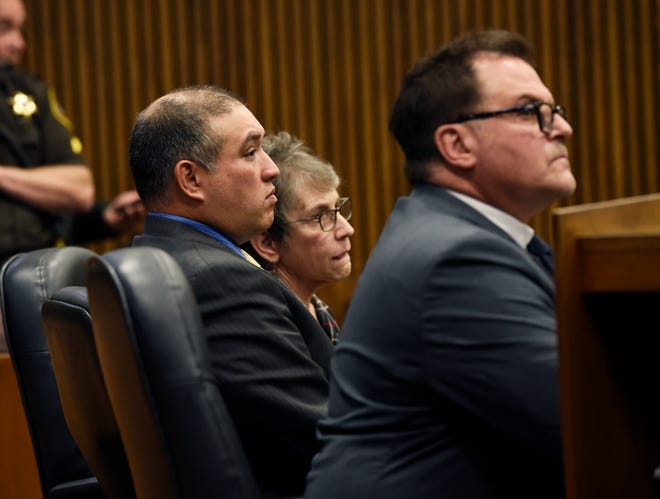 Mark Bessner, center, sits with his attorneys as they listens to Judge Margaret Van Houten give instructions to the jury after they announced that they could not reach a verdict. The judge instructed them to go to lunch and return at 1:45 p.m. to continue deliberations.