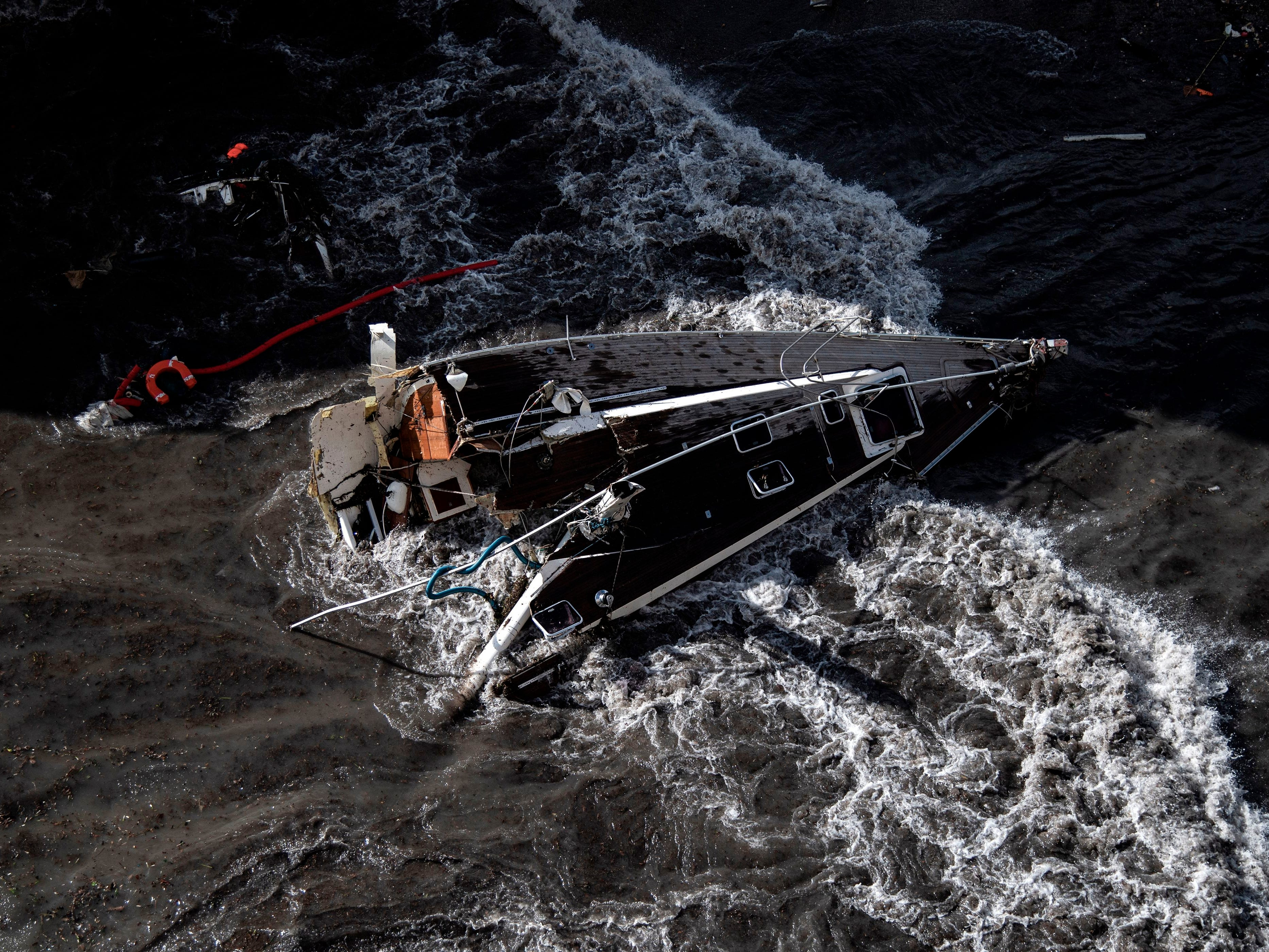 A broken yacht lies near the harbour of Rapallo, near Genoa, on Oct. 30, 2018 after a storm hit the region and destroyed a part of the dam the night before. The fierce storms battering Italy left nine dead in the night from Oct. 29-30.
