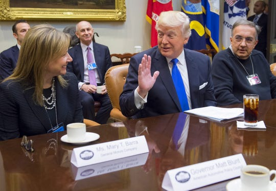 President Donald Trump speaks alongside General Motors CEO Mary Barra and Fiat Chrysler CEO Sergio Marchionne during a meeting with automobile industry leaders in the Roosevelt Room of the White House on January 24, 2017.