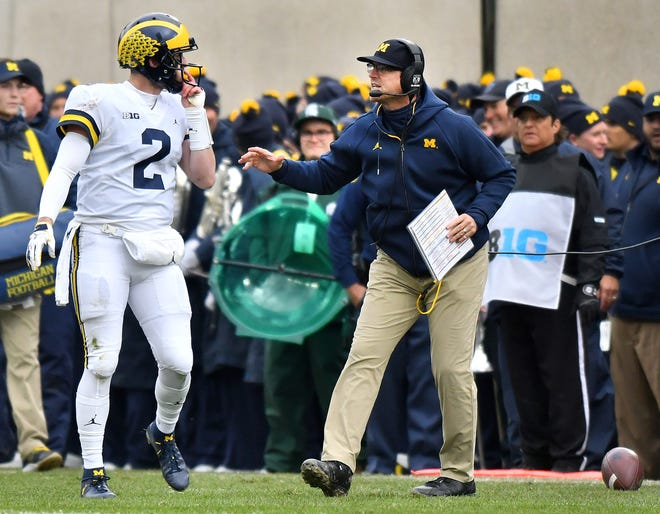 Michigan head coach Jim Harbaugh, right, and quarterback Shea Patterson will take on Penn State at home this weekend.
