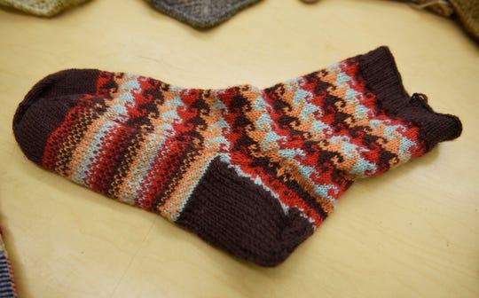 A wool sock by fiber artist Michael Fitzgerald.