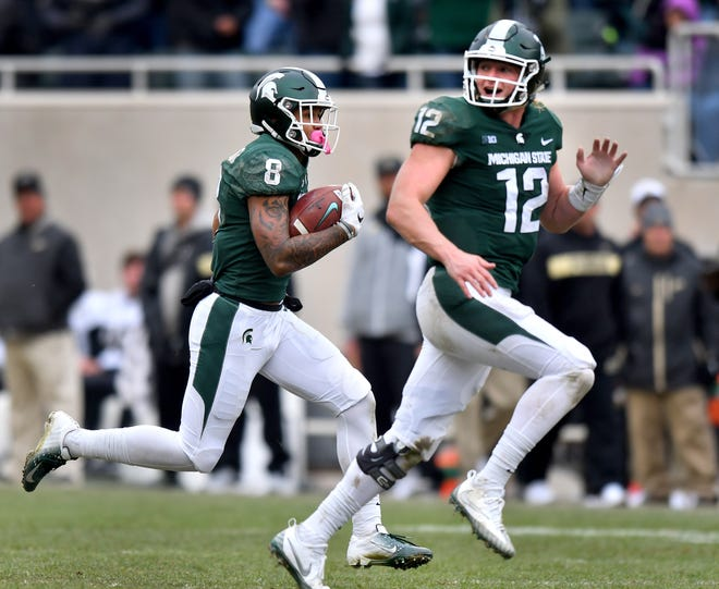 Michigan State wide receiver Jalen Nailor reverses field during a broken play and runs for a touchdown with quarterback Rocky Lombardi in last weekend's win over Purdue.
