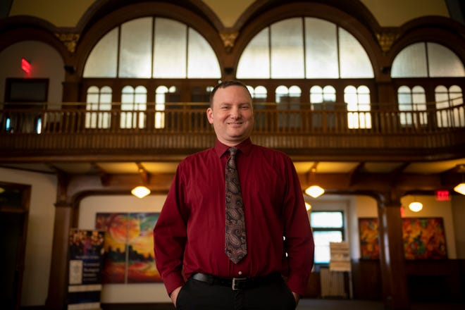 Author Brandon Grafius stands inside the Ecumenical Theological Seminary, of Detroit, where he is a professor.