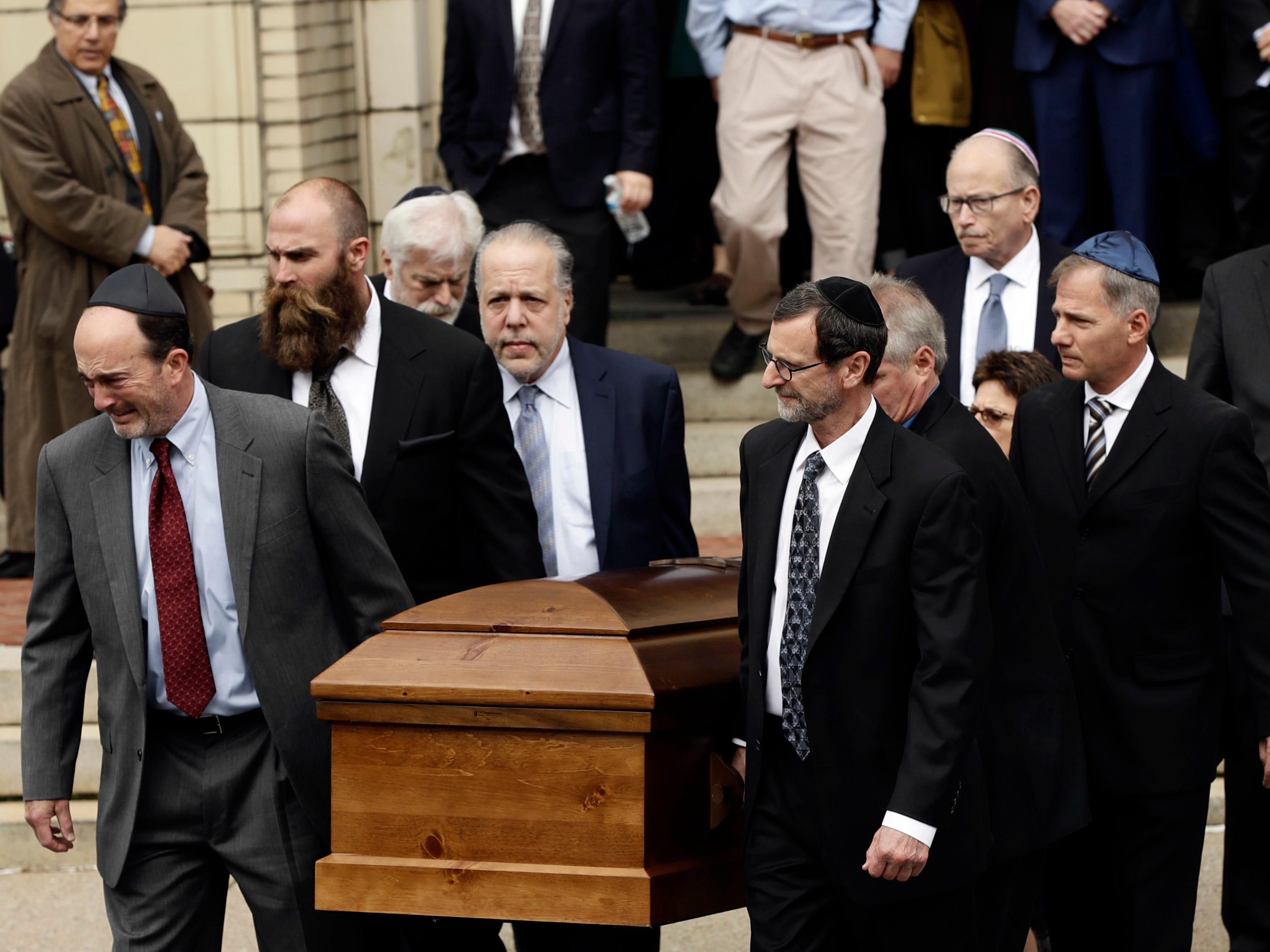 A casket is carried out of Rodef Shalom Congregation after the funeral for brothers Cecil and David Rosenthal, Tuesday, Oct. 30, 2018, in Pittsburgh. The brothers were killed in the mass shooting Saturday at the Tree of Life synagogue.