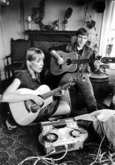 Chuck and Joni Mitchell play together in their apartment in the Verona building near Wayne State University in Detroit.