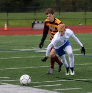 Carter McCreary of Horseheads chases the ball in front of Ithaca's Alex Krause during the Section 4 Class AA boys soccer final Oct. 29, 2018 at Ithaca High School.