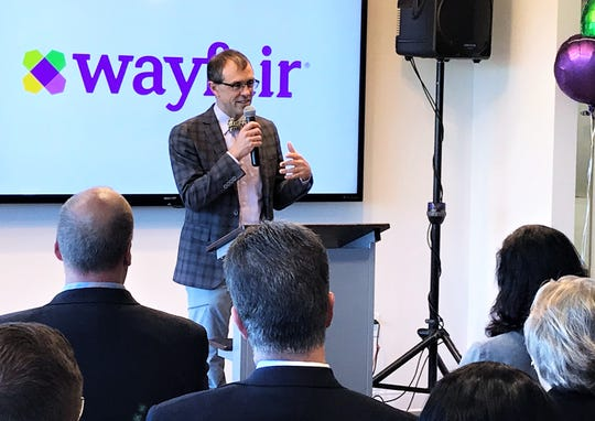 Wayfair co-founder Steve Conine talks about the company's commitment to customer service during a ceremony Tuesday to officially open a new call center in Big Flats.