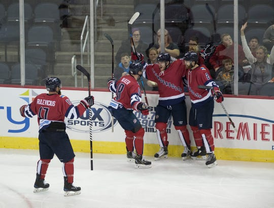 The Evansville Thunderbolts celebrate after scoring a goal during the Evansville Thunderbolts vs Peoria Rivermen game at the Ford Center Tuesday Oct. 30, 2018.