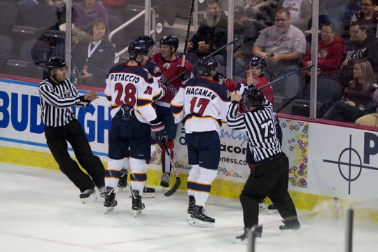 Referees break up a fight during the Evansville Thunderbolts vs Peoria Rivermen game at the Ford Center Tuesday Oct. 30, 2018.