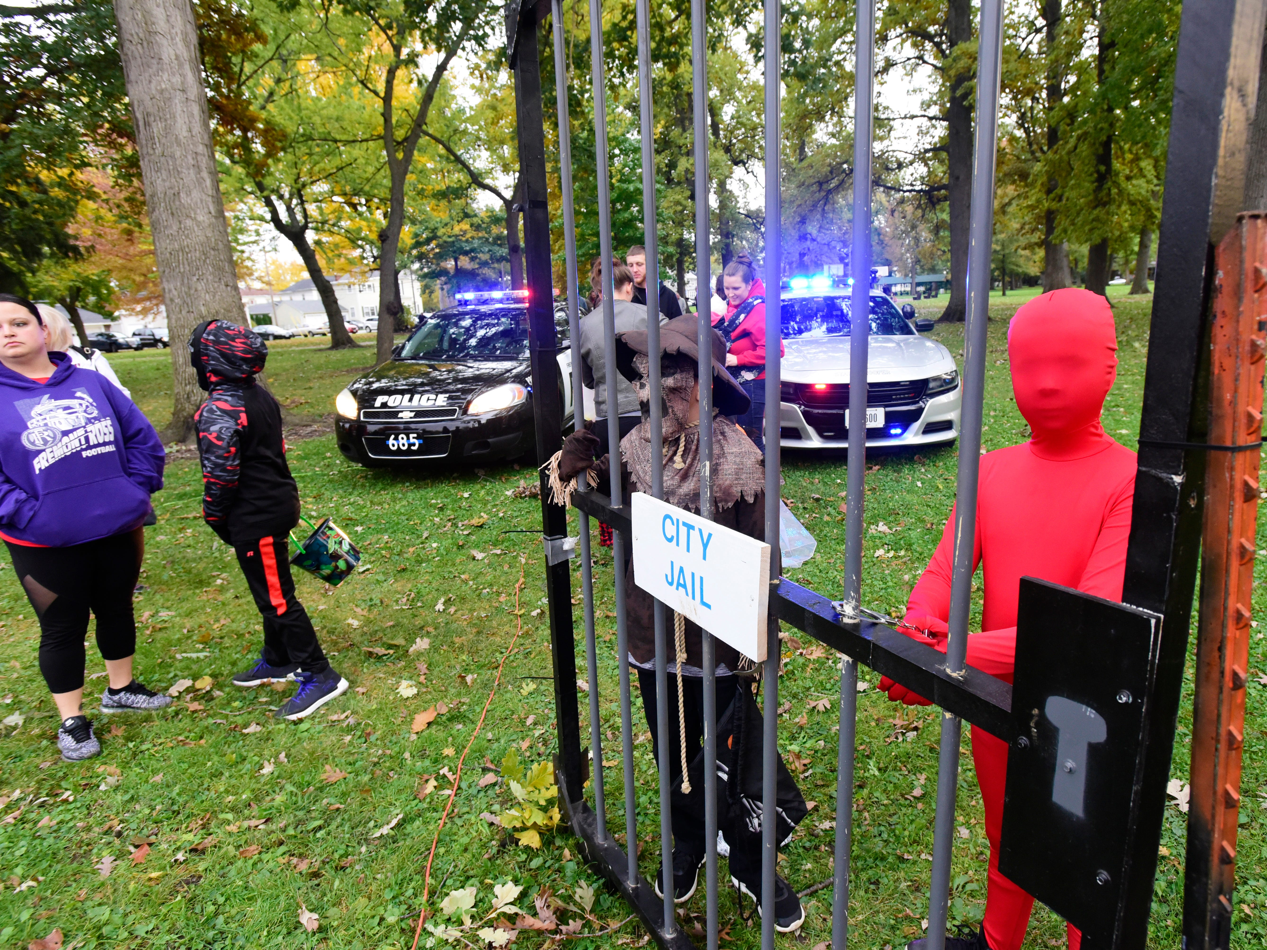 Trick-or-treaters get goodies during Candy with the Cops at Birchard Park on Tuesday evening.