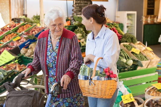 Assisted Living Senior Woman With Caregiver Shopping