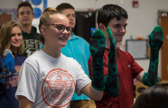 "Rayne Roe and Dante Ellingsworth show their matching socks during a ""matching ceremony"" for the Best Buddies program Monday, October 29, 2018. The match symbolizes how they will be paired as buddies during the upcoming year. Best Buddies is an inclusive group that pairs the developmentally abled with another student."