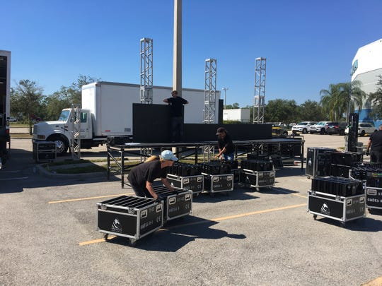 A crew from American Audio Visual sets up a big screen for the overflow crowd to watch the President Donald Trump Make America Great Again rally Wednesday night at Hertz Arena in Estero.