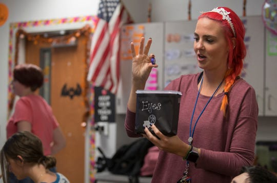 Ida Baker High School Teacher Melanie Inglis, displays what was inside one of the boxes used during a sensory exercise for her life skills class for exceptional students education Monday, October 29, 2018.