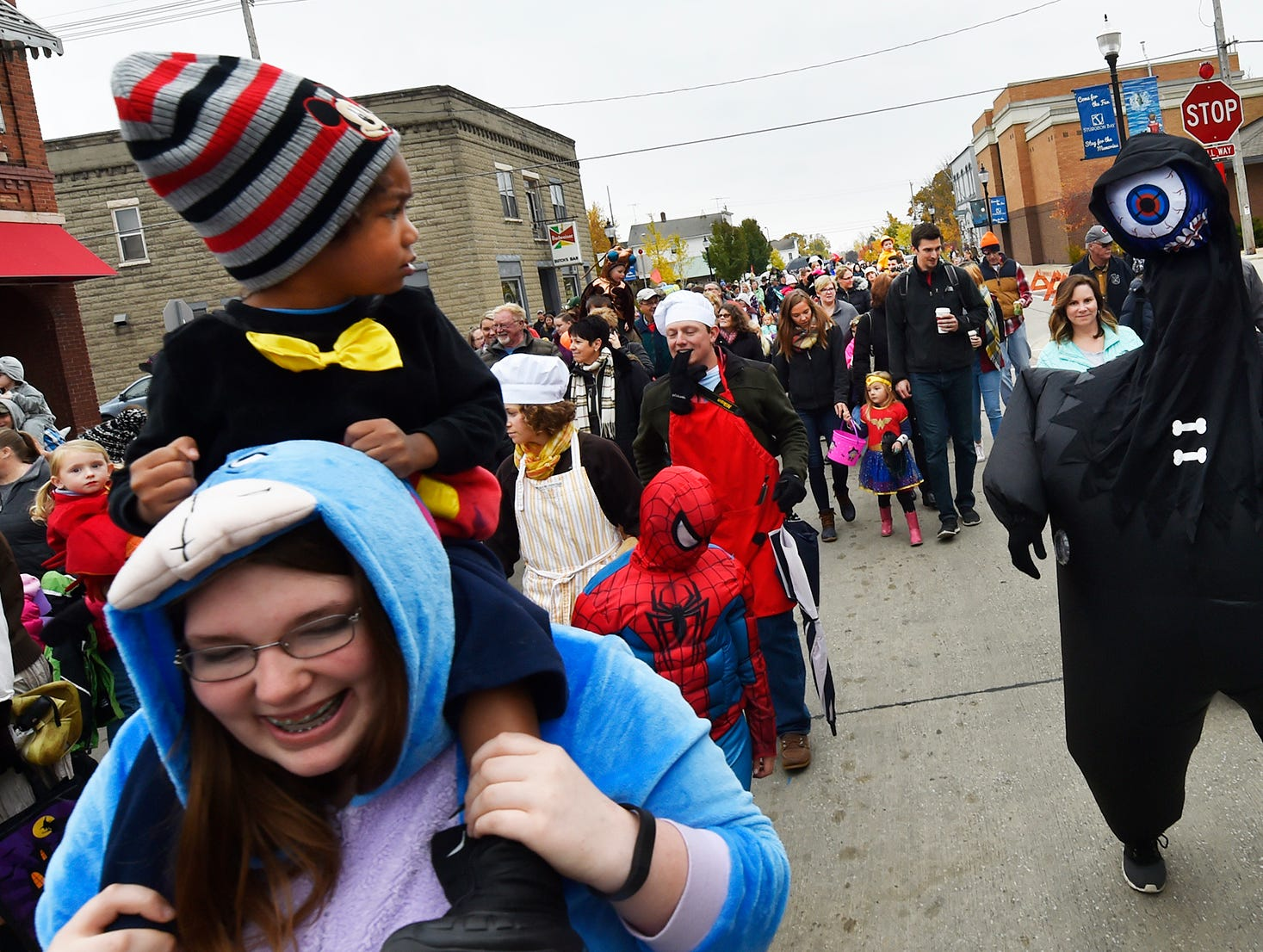 It was a stare-down match between a  skepitcal Blaze Starr (on the shoulders of Alexis Fickett) and the One-Eye Monster (Tyler Olson) during the seventh annual Thrills On Third costume parade on Saturday, Oct. 26, 2018. Tina M. Gohr/USA TODAY NETWORK-Wisconsin