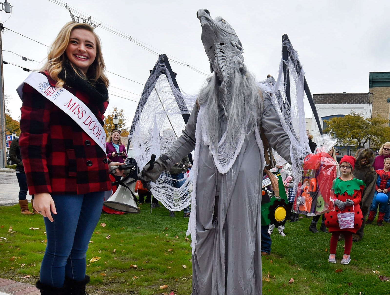 Miss Door County Outstanding Teen Ashley Ellefson hands third place to Paul Filar at the Thrills on Third costume parade on Saturday, Oct. 27, 2018, in Sturgeon Bay. Tina M. Gohr/USA TODAY NETWORK-Wisconsin