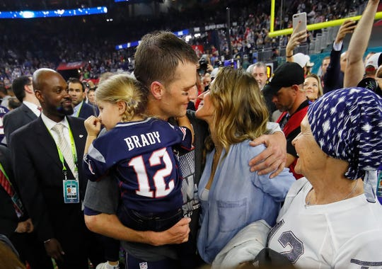 Tom Brady of the New England Patriots celebrates with wife Gisele Bundchen and daughter Vivian Brady after defeating the Atlanta Falcons during Super Bowl LI in 2017.