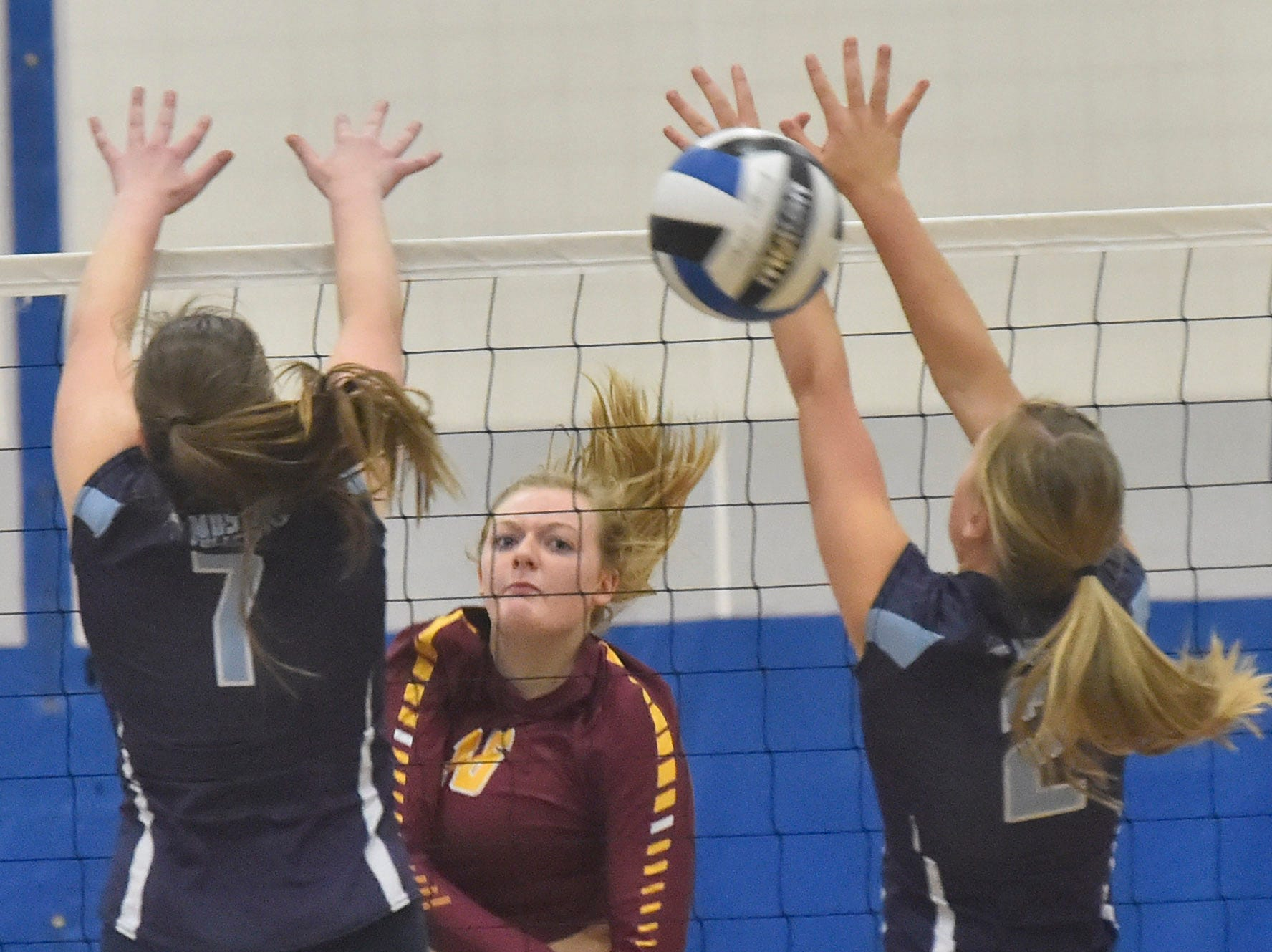 Peyton VandenBush of Luxemburg-Casco hits the ball pass Little Chute defenders Luxemburg-Casco at the WIAA Division 2 sectional final against Little Chute on Oct. 27, 2018, in Wrightstown. Tina M. Gohr/USA TODAY NETWORK-Wisconsin