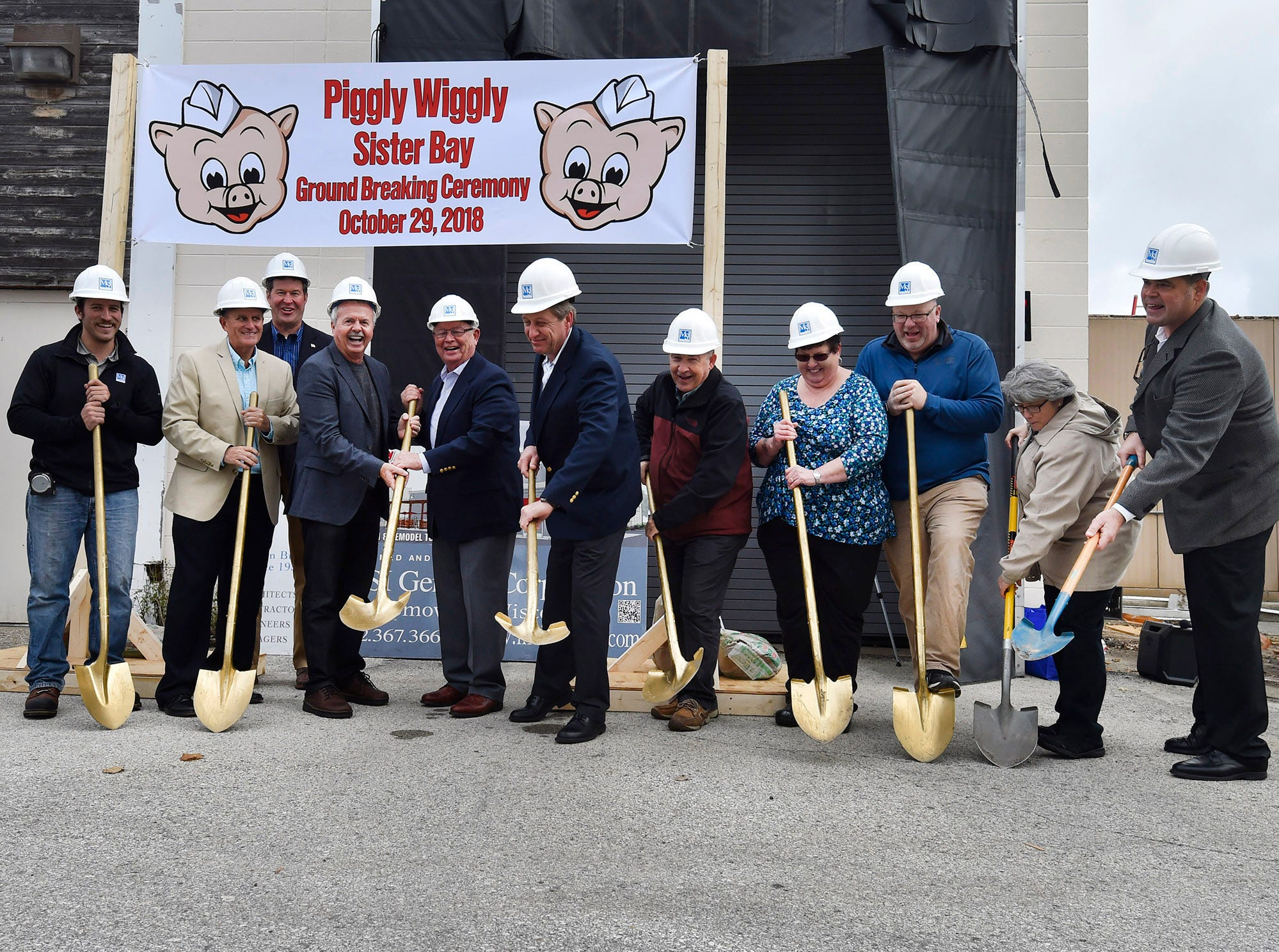 Piggly Wiggly and Sister Bay representatives take part in a ground-breaking ceremony at Piggy Wiggly Sister Bay, 10576 Country Walk Drive, on Oct. 29, 2018. After the expansion project is completed, the store will increase in size by about 70 percent. Tina M. Gohr/USA TODAY NETWORK-Wisconsin
