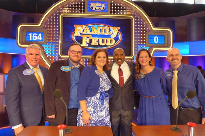 "The Anderson family of Oshkosh appears on the set of ""Family Feud"" with host Steve Harvey, fourth from left. Contestants are Dan Anderson, from left, Peter Hernet, Stefanie Hernet, Kristin Bird and Tony Bird. Their episode airs at 9 a.m. Nov. 13."