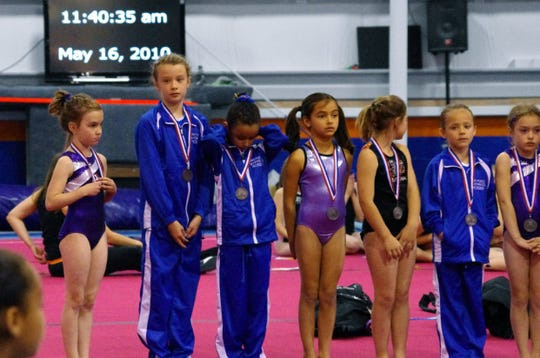 Mady Draak, second from left, became a bit too tall for gymnastics.