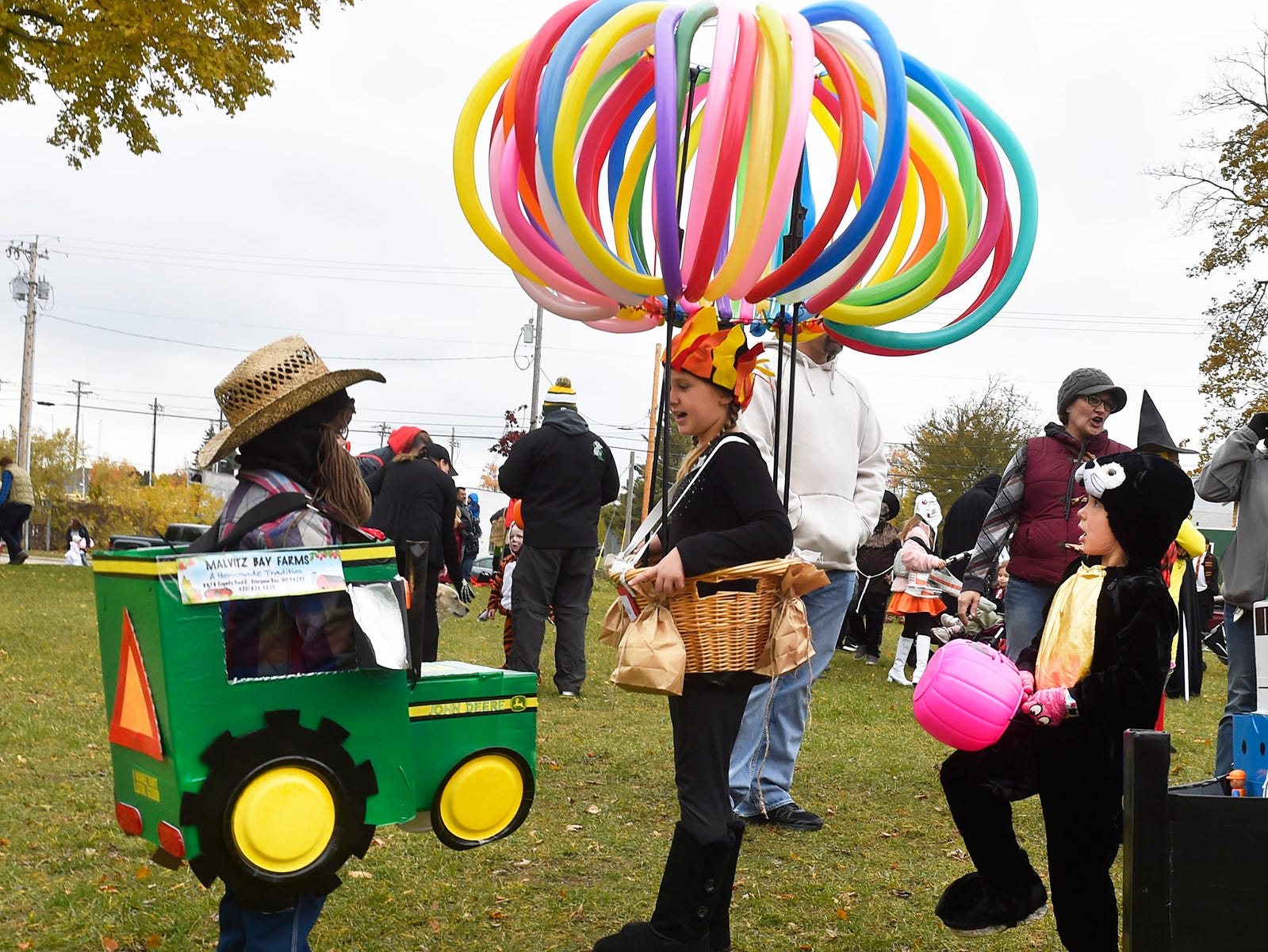 Nathan Sixel, from left, Audrie Schley and Monica Petrina check out each other's costumes at Martin Park prior to the Thrills on Third costume parade on Saturday, Oct. 27, 2018, in Sturgeon Bay. Tina M. Gohr/USA TODAY NETWORK-Wisconsin