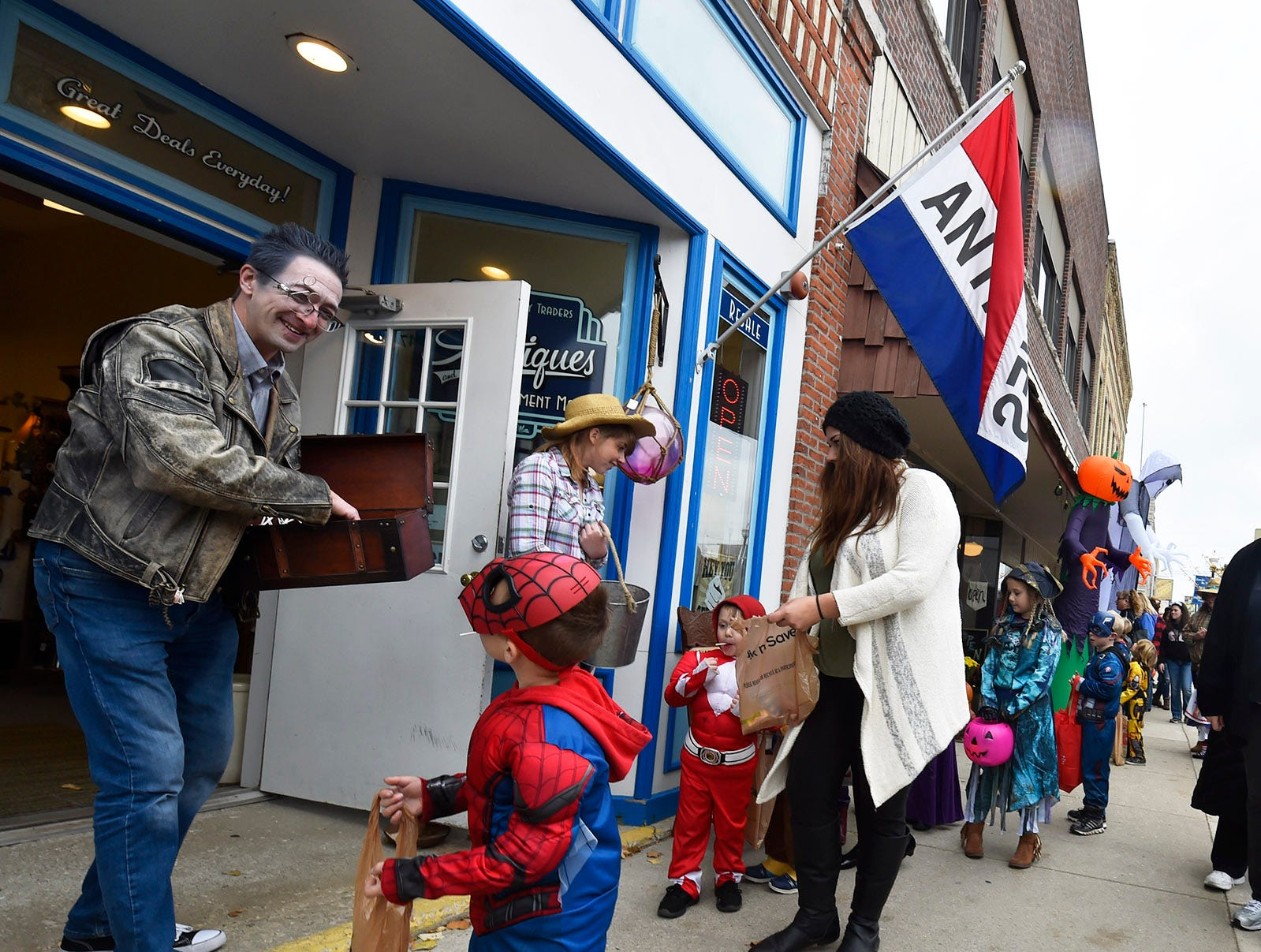 Tristan Wier of WierClock hands out candy on North Third Avenue at the Thrills on Third costume parade on Saturday, Oct. 27, 2018, in Sturgeon Bay. Tina M. Gohr/USA TODAY NETWORK-Wisconsin