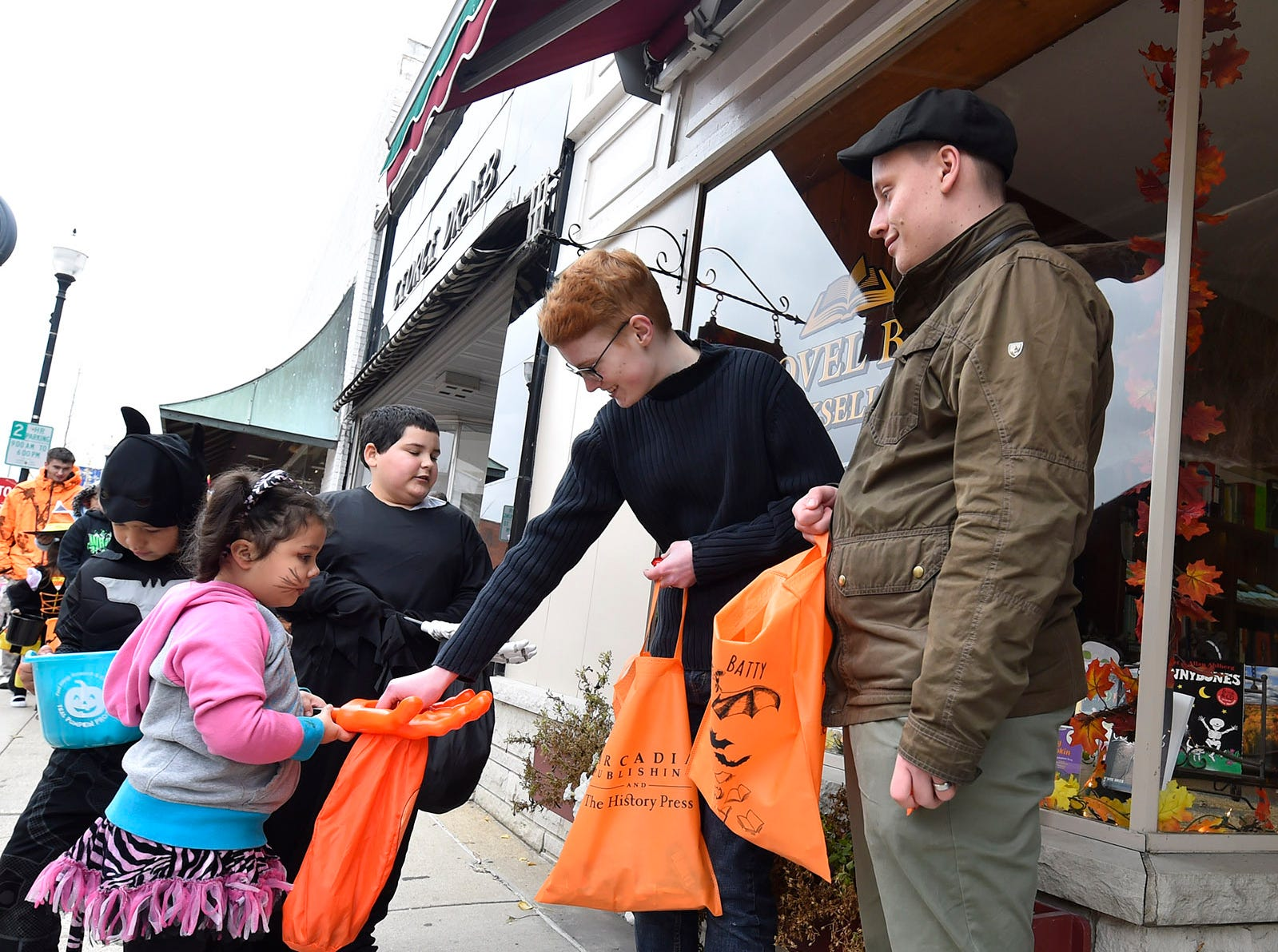 Vanessa Koopman and Mike Maggetti hand out candy at Novel Bay Booksellers following the Thrills on Third costume parade on Saturday, Oct. 27, 2018, in Sturgeon Bay. Tina M. Gohr/USA TODAY NETWORK-Wisconsin