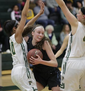Bay Port's Mady Draak has developed into one of the top basketball players in the area thanks to a strong work ethic.
