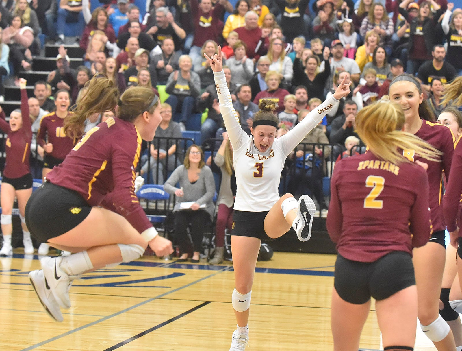 AManda Miceli, center, and Claire Coppens, left, celebrate a point against Little Chute at the WIAA Division 2 sectional final against Little Chute on Oct. 27, 2018, in Wrightstown. Tina M. Gohr/USA TODAY NETWORK-Wisconsin