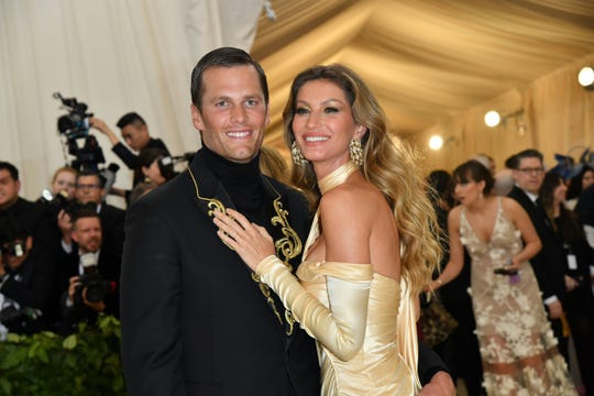 New England Patriots quarterback Tom Brady and wife Gisele Bundchen arrive for the 2018 Met Gala on May 7 at the Metropolitan Museum of Art in New York.