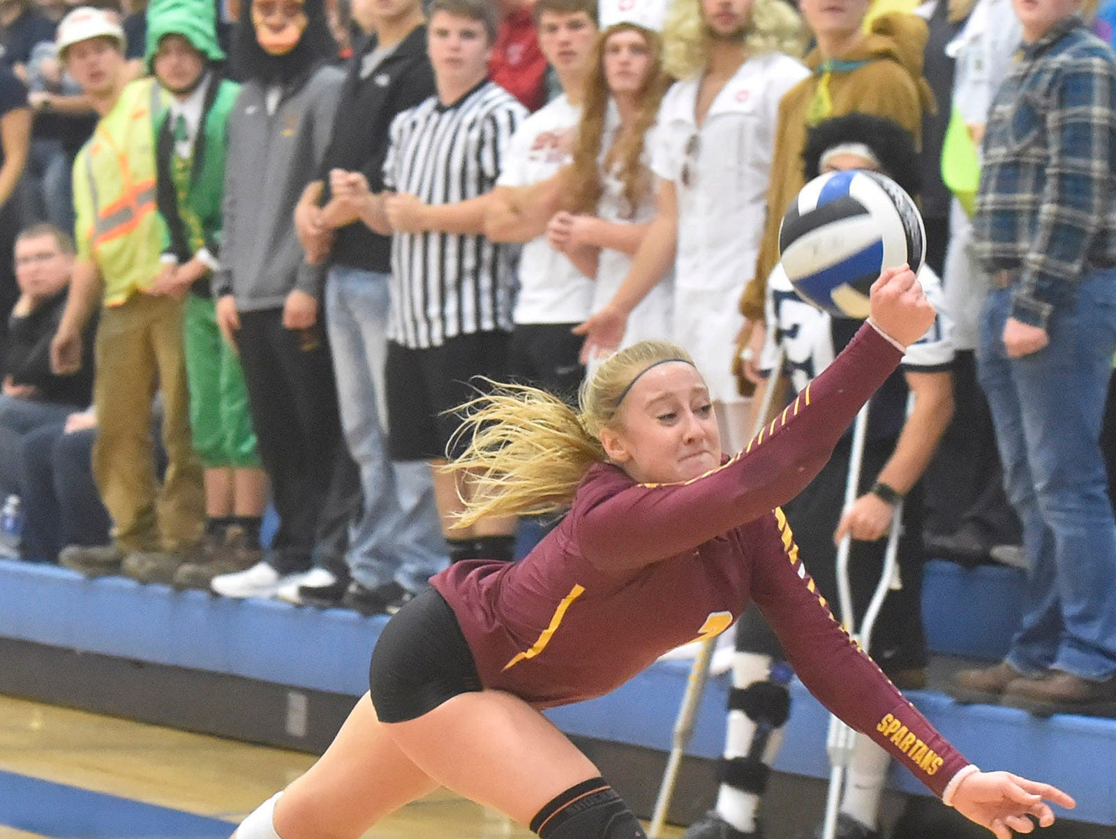 Rebekah Day of Luxemburg-Casco saves the ball with a back-handed hit against Little Chute during the WIAA Division 2 sectional championship at Wrightstown on Saturday, Oct. 27, 2018.  Tina M. Gohr/USA TODAY NETWORK-Wisconsin