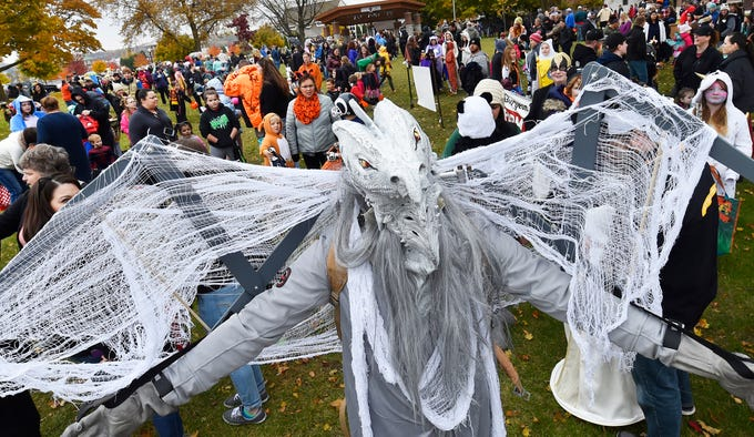 "A ghoulish mob including a spooky winged dragon (Paul Filar), stage at Martin Park before marching in the Thrills On Third costume parade on Saturday, Oct. 27, 2018 in Sturgeon Bay. Winning the costume contest was Ophelia Linnan, runnerup was Audrie Schley and third went to Paul Filar. About 1,000 people marched in the parade. Following the parade, businesses along North Third Avenue handed out candy. The day also featured a haunted house at the Door County Boys & Girls Club and ""slime-making'' at the Door County Library. . Tina M. Gohr/USA TODAY NETWORK-Wisconsin"
