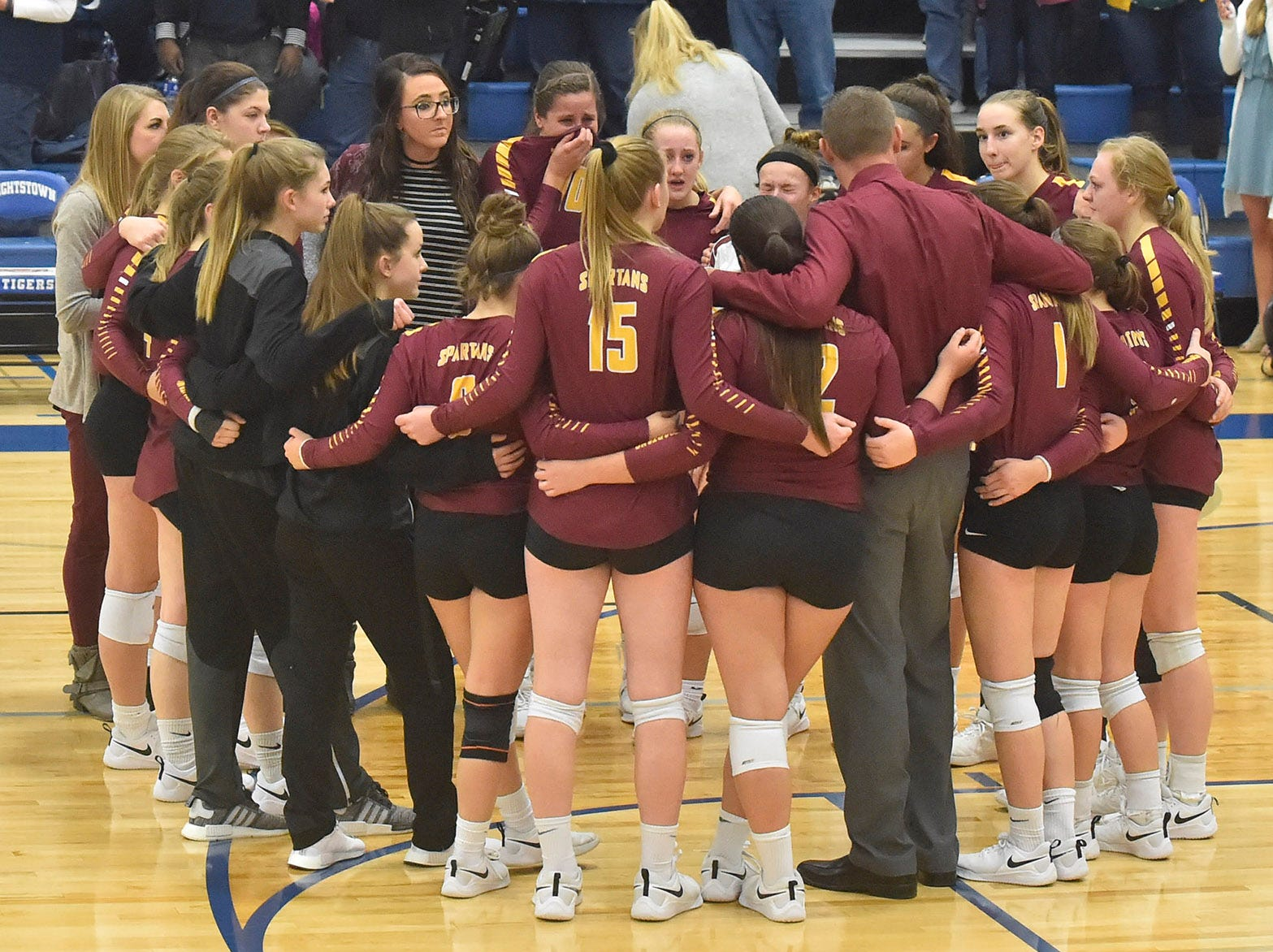 The Luxemburg-Casco volleyball team listens to a post-game talk by coach Jeff Frey after the team lost its bid to return to state on Saturday, Oct. 27, 2018. The Spartans lost the Division 2 sectional championship to Little Chute 3-1 at Wrightstown. Tina M. Gohr/USA TODAY NETWORK-Wisconsin