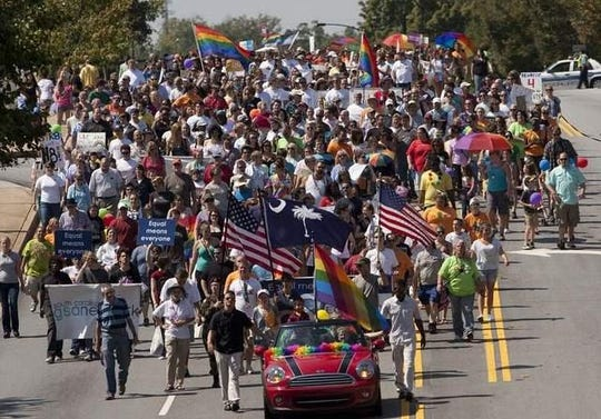 A report Greenville-based Pride Link says data suggests there are about 100,000 LGBTQ individuals living in the state. (Photo provided by  Upstate Pride SC, which annually hosts a March & Festival that draws hundreds of marchers in support of the LGBTQ community.