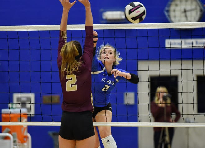 St. Joseph's Katie Culumovic (2) tries to get the ball past a Buford blocker Monday night during the host Knights' victory in the second round of the Class AA volleyball playoffs.