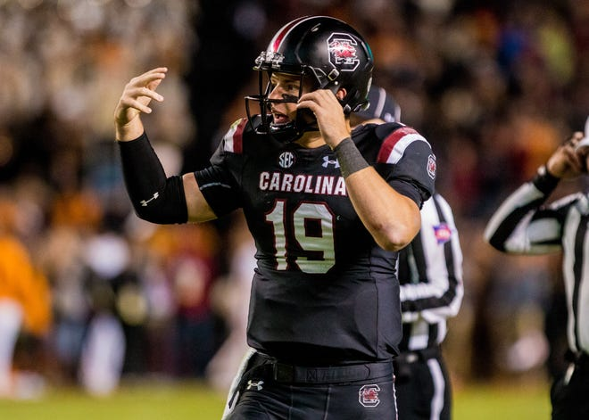South Carolina Gamecocks quarterback Jake Bentley (19) directs his team against the Tennessee Volunteers at Williams-Brice Stadium.