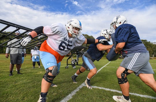 Southside Christian linemen, from left, Justin DeStefano, Zack Zivitski and Will Ramey run drills during the team's practice Oct. 22.