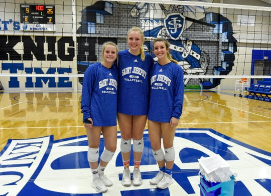 St. Joseph's seniors, from left, Katie Culumovic, Lauren DeLo and Kyra Thompson were honored following the Knights' three-set win over Buford in the second round of the Class AA volleyball playoffs Monday night.
