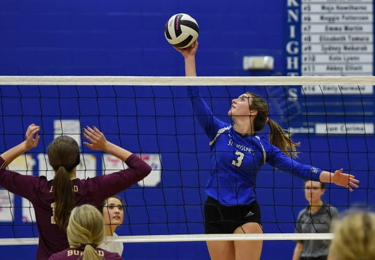 St. Joseph's Kyra Thompson (3) focuses on her return shot against visiting Buford in the second round of the Class AA volleyball playoffs Monday night.