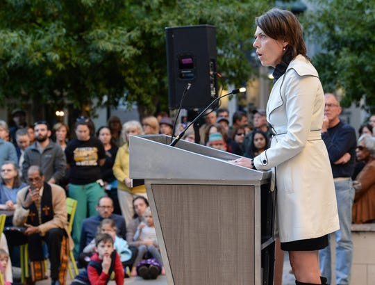 Amy Doyle of the Greenville city council speaks during a vigil for the victims from the Tree of Life Synagogue in Pittsburgh, a moment of reflection in the NOMA Square in downtown Greenville on Tuesday.