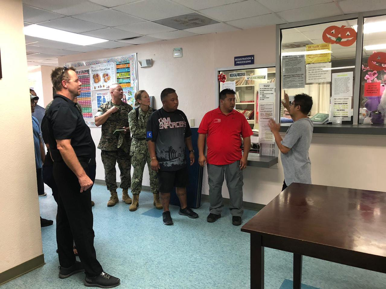 TINIAN, Commonwealth of the Northern Mariana Islands (Oct. 28, 2018) — Col. Brent Bien, Marine Corps Activity Guam officer in charge; Rear Adm. Shoshana Chatfield, Commander, Joint Region Marianas/Commander, Task Force West; officials from the Federal Emergency Management Agency, and local authorities visit a healthcare facility in Tinian to assess damage and discuss ongoing recovery efforts following Super Typhoon Yutu Oct. 28. Service members from Joint Region Marianas and Indo-Pacific Command are providing Department of Defense support to the CNMI's civil and local officials as part of the FEMA-supported Super Typhoon Yutu recovery effort.