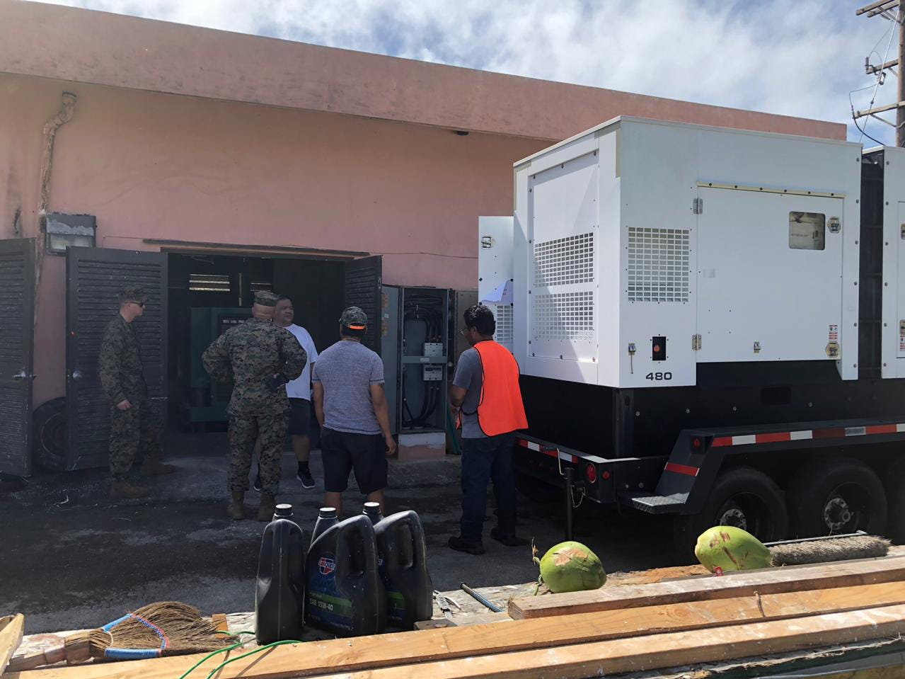 TINIAN, Commonwealth of the Northern Mariana Islands (Oct. 28, 2018) — U.S. Army Corps of Engineers, U.S. Air Force and U.S. Marine Corps personnel deliver a generator the water pumping station in Tinian Oct. 28. Personnel worked with local authorities reestablish capabilities and provide clean drinking water to the local community. Service members from Joint Region Marianas and Indo-Pacific Command are providing Department of Defense support to the CNMI's civil and local officials as part of the FEMA-supported Super Typhoon Yutu recovery effort.