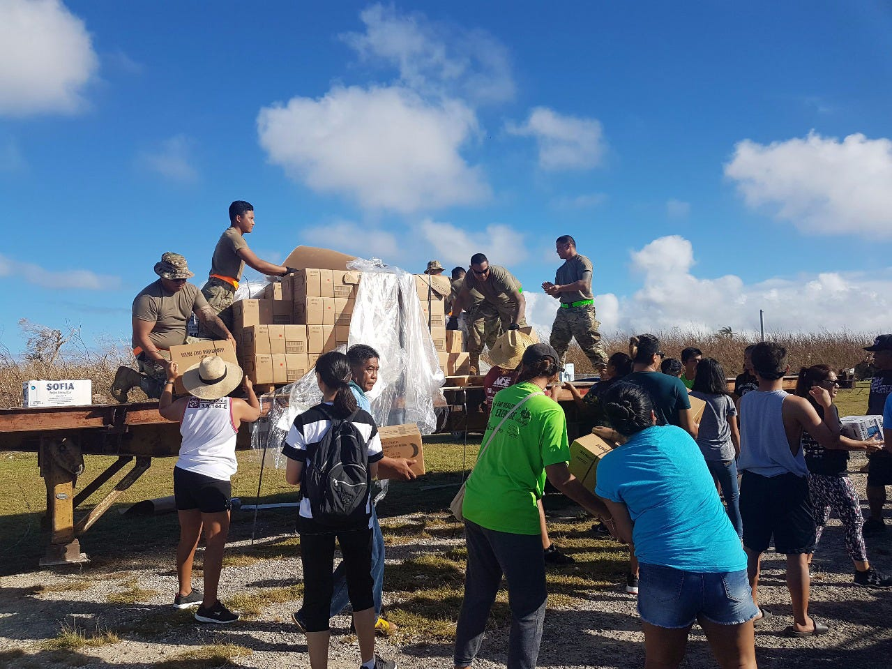 SAIPAN, Commonwealth of the Northern Mariana Islands (Oct. 28, 2018) — Guam-based U.S. Army reservists from Echo Company 100th Battalion, 442nd Infantry Division, volunteer to distribute relief supplies to island residents affected by Super Typhoon Yutu in Saipan Oct. 28. Service members from Joint Region Marianas and Indo-Pacific Command are providing Department of Defense support to the Commonwealth of the Northern Mariana Islands' civil and local officials as part of the FEMA-supported Super Typhoon Yutu recovery effort.