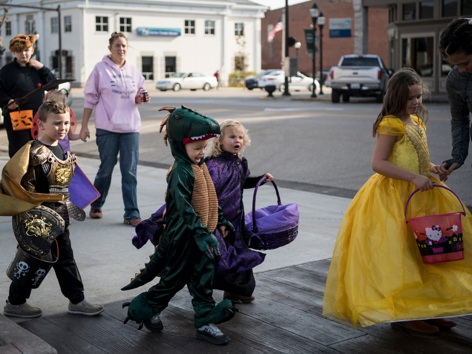 Children walk down Second Street during the Central Business District trick-or-treat event in downtown Henderson, Ky., Tuesday, Oct. 30, 2018. Due to a forecast calling for significant rain on Halloween day, the Rotaract of Henderson moved it's Downtown Trick-Or-Treat event to Tuesday evening from 3-5 p.m.