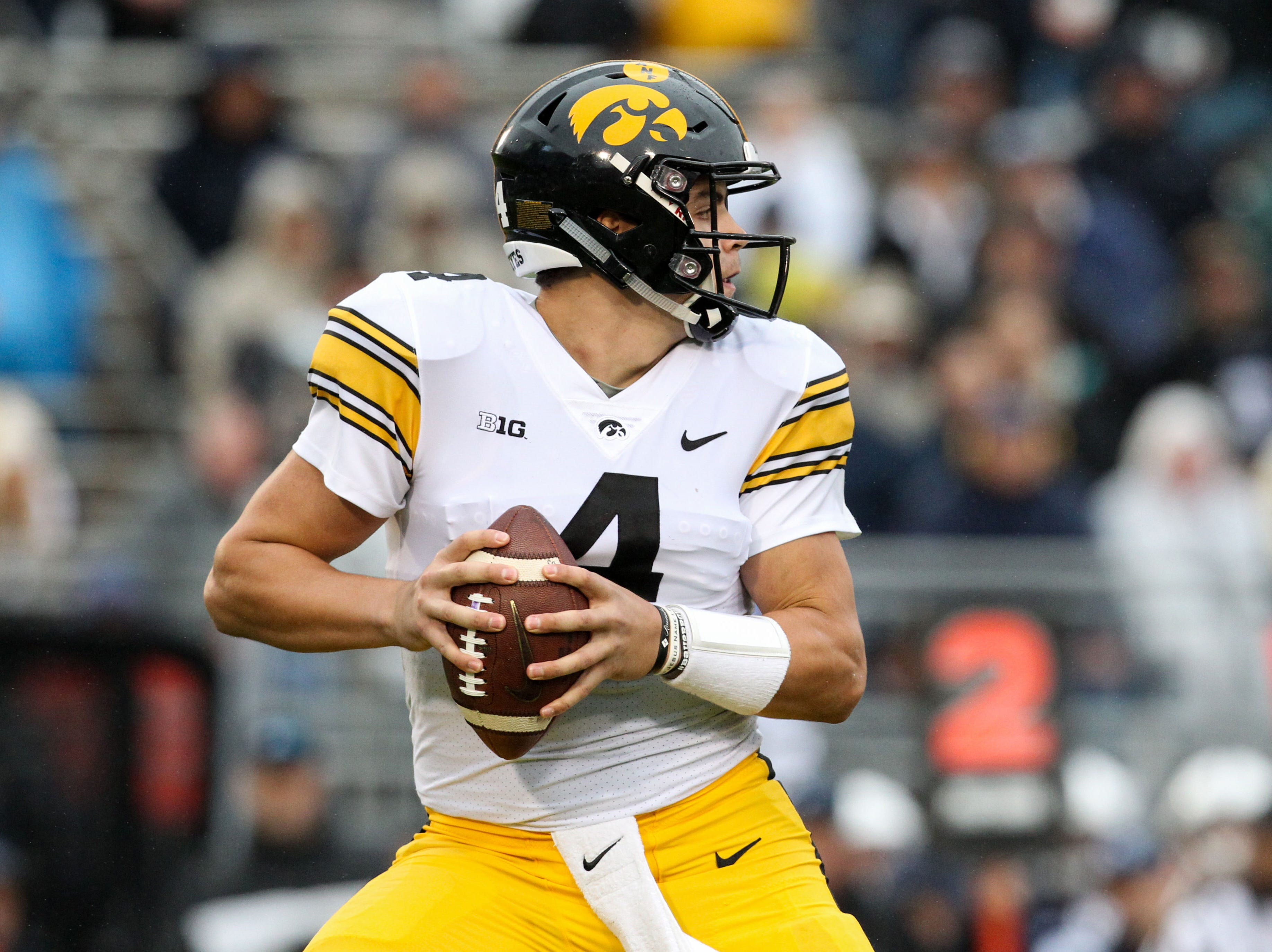 Hawkeyes quarterback Nate Stanley (4) drops back in the pocket during the second quarter against the Penn State Nittany Lions at Beaver Stadium.