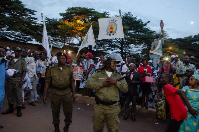 """In this photo taken Monday Oct. 22, 2018, supporters of Cameroon's Incumbent President Paul Biya, of the Cameroon People's Democratic Movement party celebrate his election victory in Yaounde, Cameroon. Africa's oldest president, Biya, easily won a seventh term on Monday after a Constitutional Council that he appointed rejected all legal challenges to the election. The United States noted irregularities that """"may not have affected the outcome but created an impression that the election was not credible or genuinely free and fair."""""""