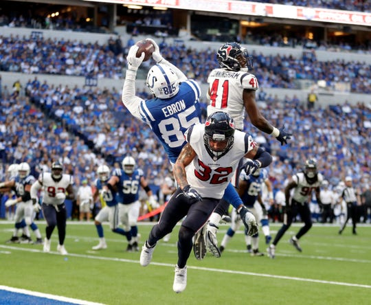 Sept. 30, 2018: Ebron (85) makes a touchdown reception against Houston Texans' Tyrann Mathieu (32) and Zach Cunningham (41) during the second half of the game in Indianapolis.